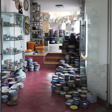 Ceramic platters and dishes line the halls