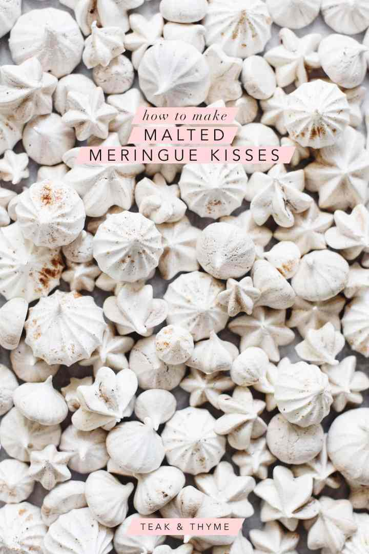 Overhead shot of many malted meringue kisses scattered on grey background