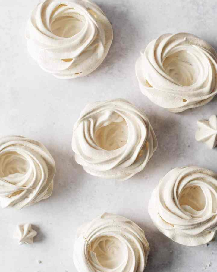 Overhead shot of empty pavlova meringues before being filled with curd