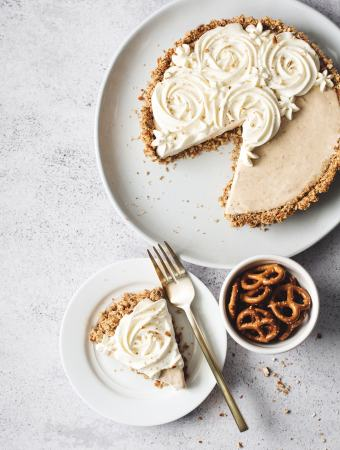 One slice of peanut butter ice cream pie next to the rest of the pie