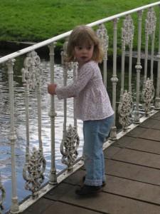 Katie playing pooh sticks