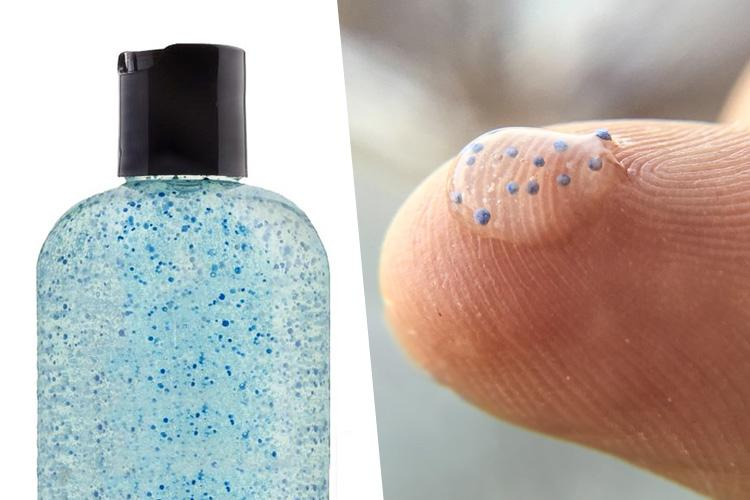 Bottle of exofoliant with small blue microbeads.