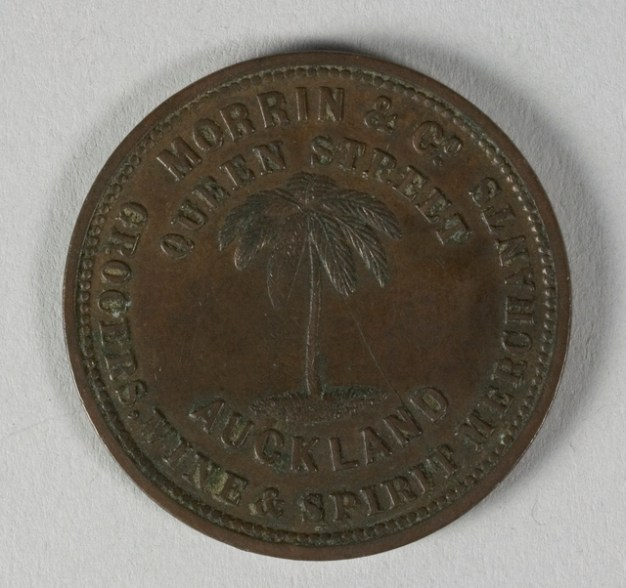 Obverse of token issued by Morrin & Co., New Zealand, minted by Heaton & Sons of Birmingham. Te Papa (NU002363)