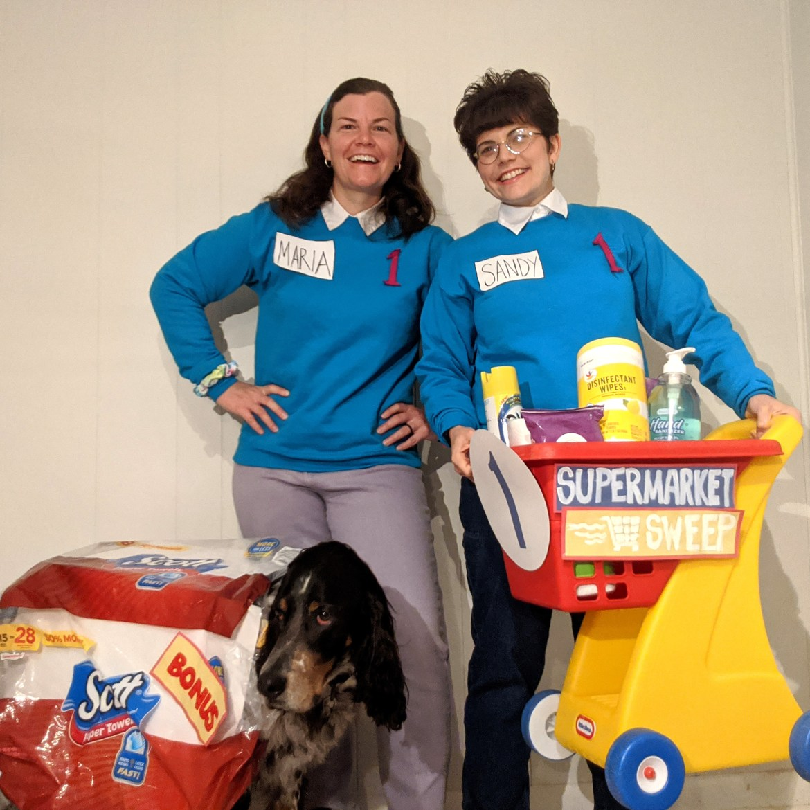 "Women dressed as ""Supermarket Sweep"" contestants"