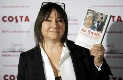 """Ali Smith, Nominee in the 2014 Costa Book Awards and winner of the Costa Novel Award category, poses with her book """"How to be Both"""" prior to the announcement of the overall winner, in London, January 27, 2015. REUTERS/Peter Nicholls"""