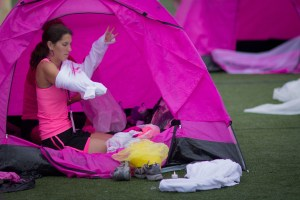 A Susan G. Komen Boston 3-Day® walker suits up in her tent on the last day