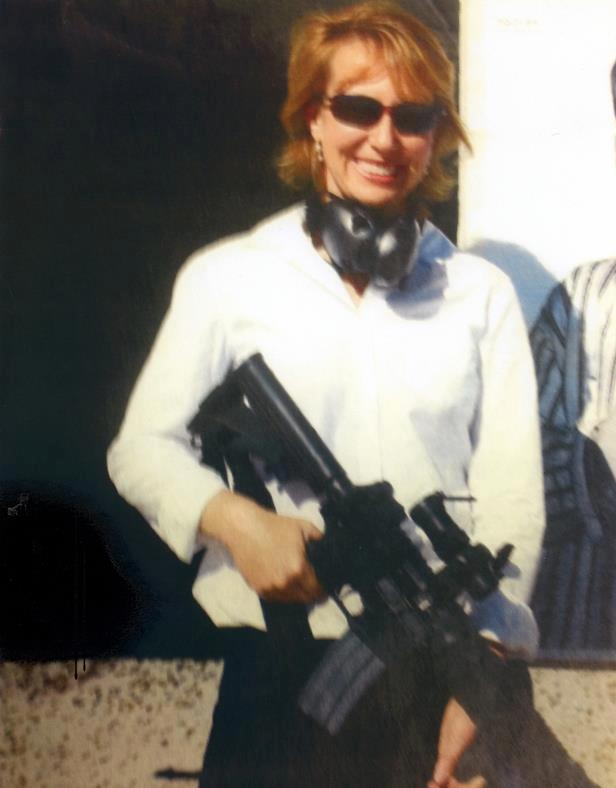 Gabrielle Giffords holding an AR-15 at the shooting range