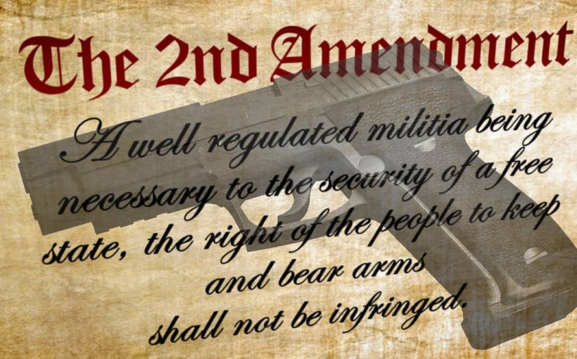 ghosted pistol image over a parchment of the second amendment