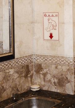 Restaurant restroom instructions Cambodia