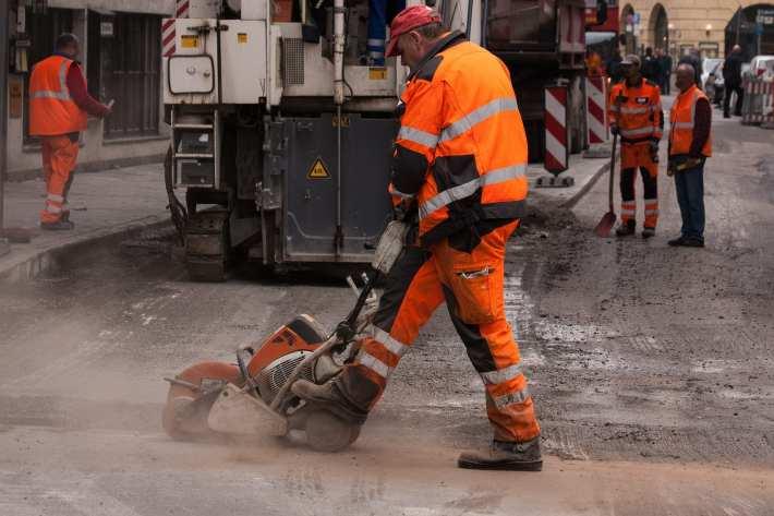 A man performing road construction.
