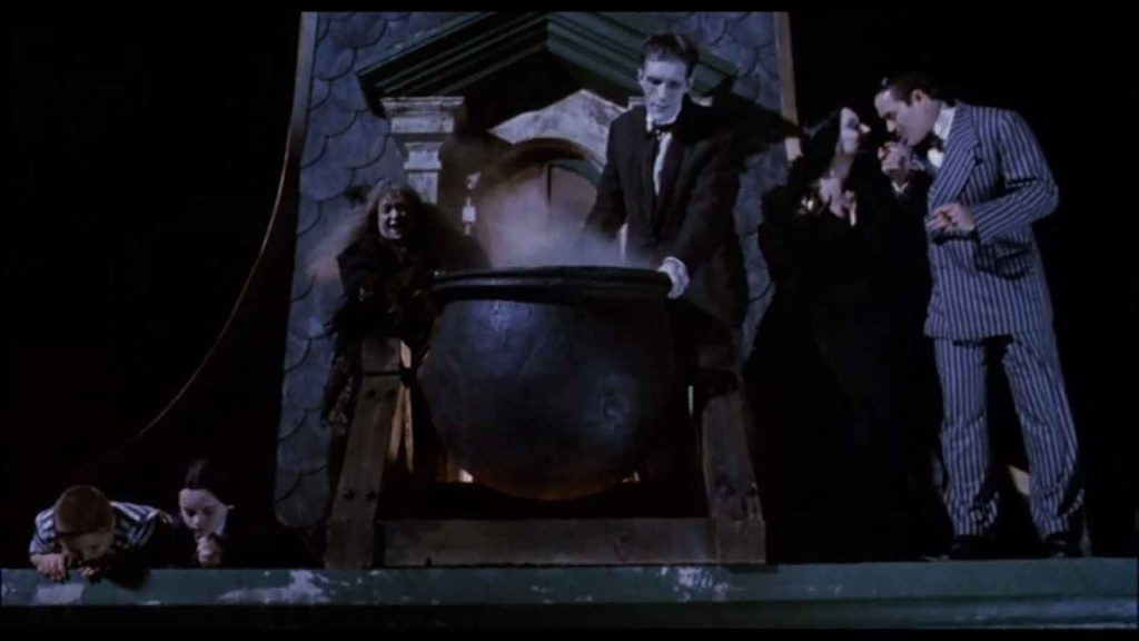 The Addams Family opening scene where they gleefully pour oil on carolers.