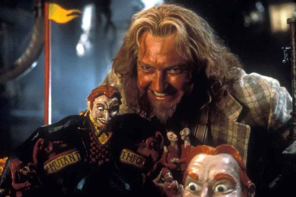 A scene of a devilishly grinning man from the movie Freaked.