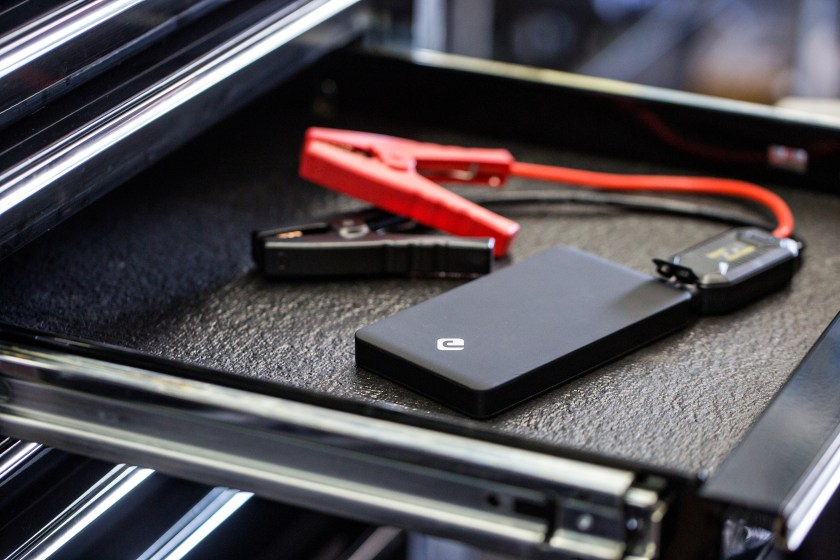 A JunoJumper portable jump starter tool for your car is seen with jumper cables