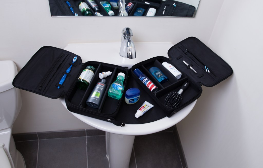 Everything ORGO is the perfect travel solution for laying out men's bath products over a sink