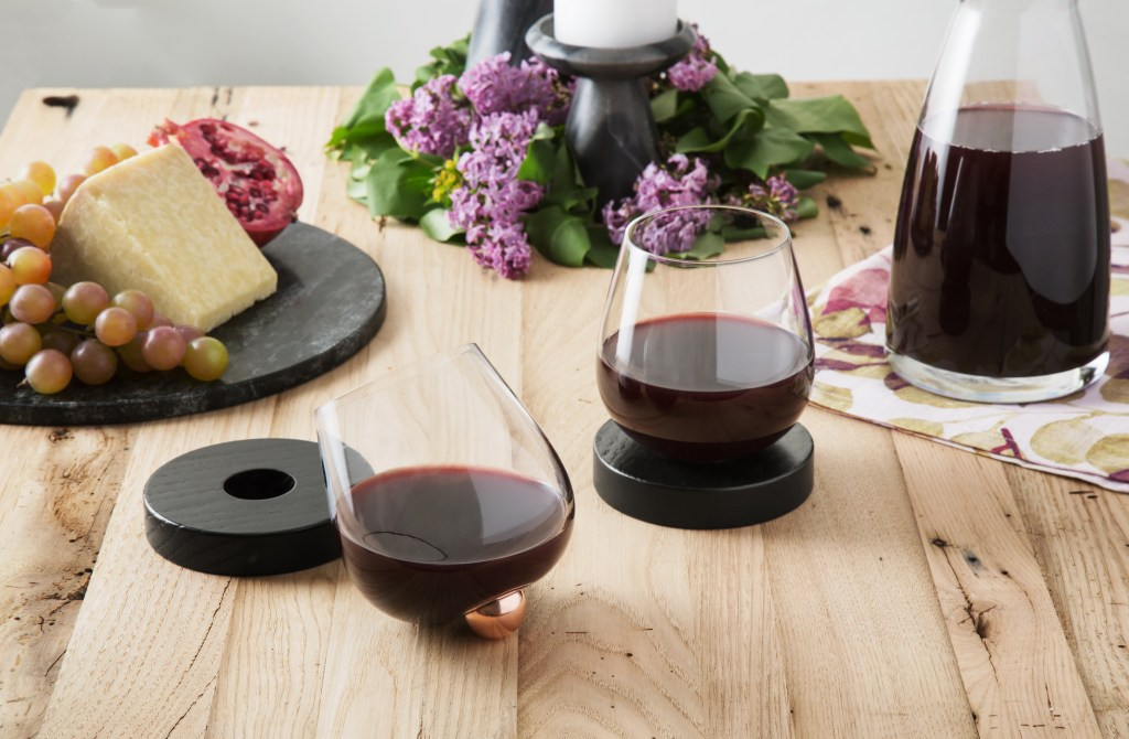 Red wine decants in stemless no-spill aerating wine glasses from Aura Glass