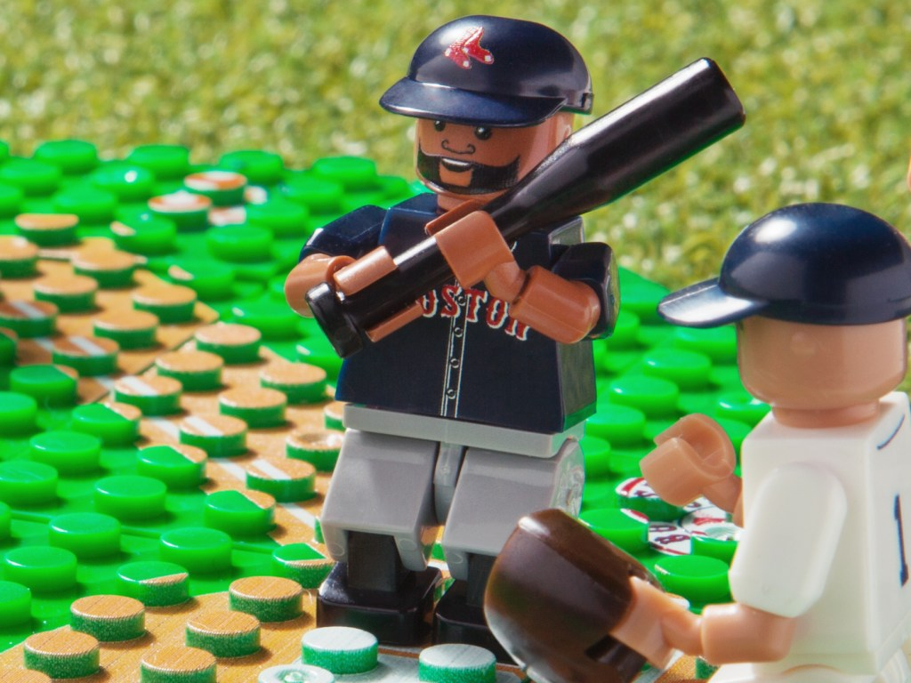 An OYO toy version of the Red Sox' Big Papi poses with a baseball bat in hand on a toy field