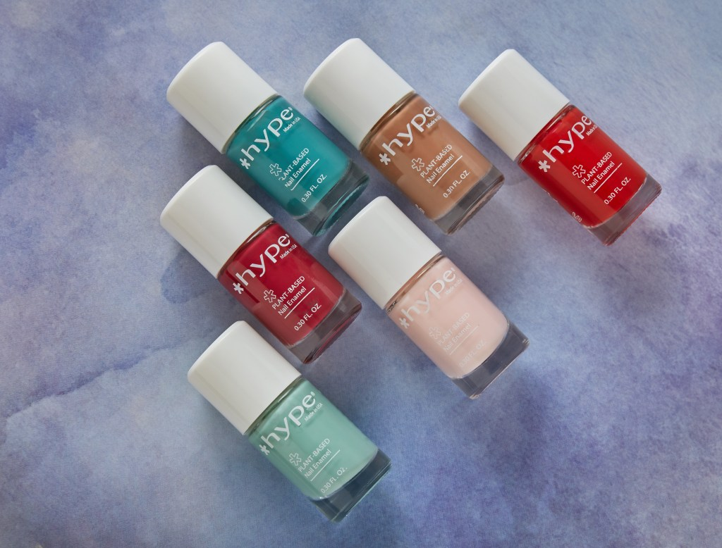 6 bottles of *hype 7-Free nail polish are seen laying on a table