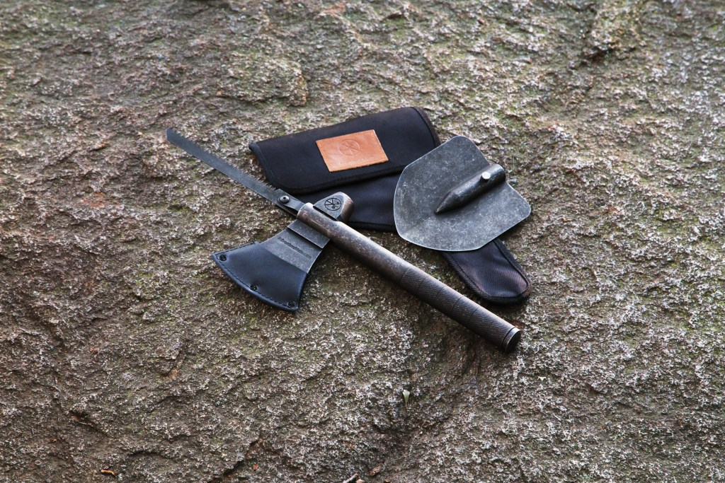 A 5-in-1 multi tool from Adventure Mate is seen sitting on a rock