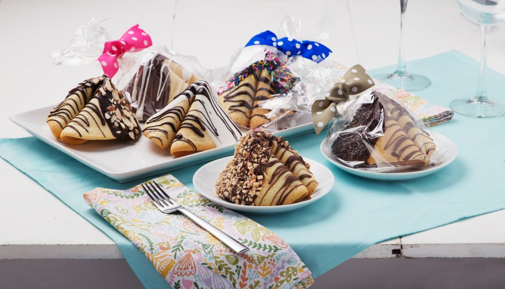 Giant chocolate covered fortune cookies from Fantastic Fortune Cookies sit on a table