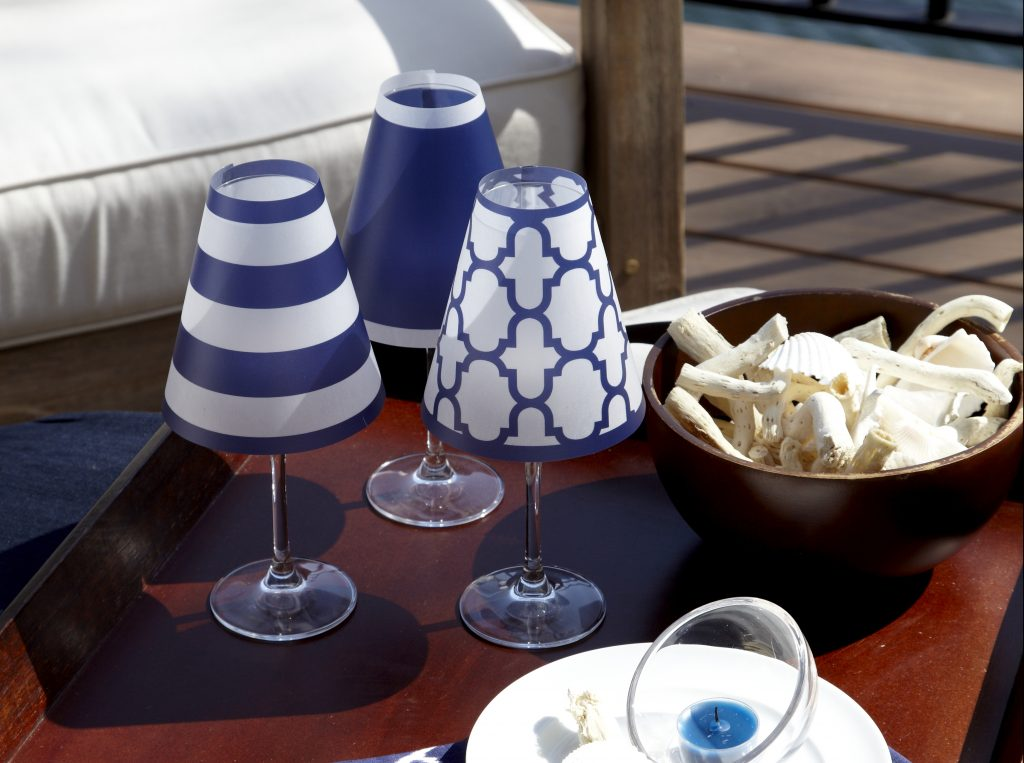 Decorative blue & white lamp shades from di Potter transform ordinary wine glasses into votive holders