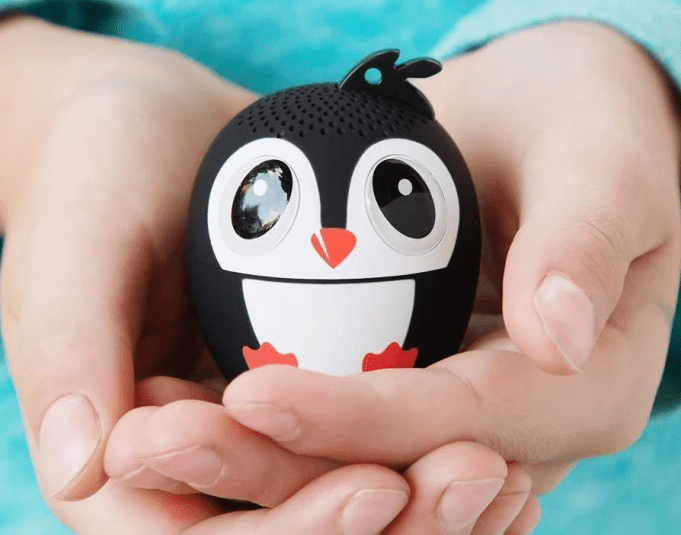 Close up of a child holding a penguin My Audio Pet digital bluetooth speaker