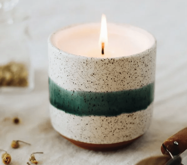 A green & white speckled Edith growing candle from Hyggelight is seen burning on a table