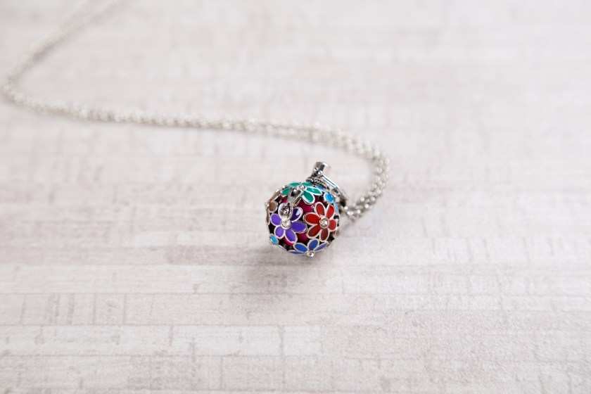 A multi-colored angel locket from Yourself Expression