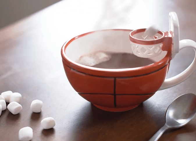 Marshmallows are tossed into hot chocolate like a free throw with the basketball sports mug from Maxi's Creations