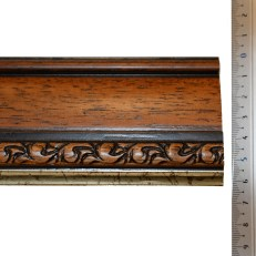 Wide wood frame with beveled outer edge, carved motive and distressed gold inner edge. 65mm