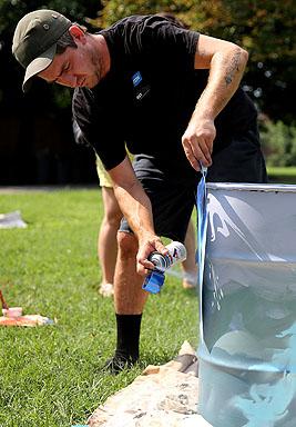 Spraying a can to prep it for some nautical art. Photo credit: Brian Schneider, www.ebrianschneider.com