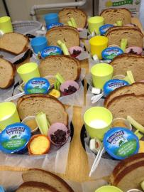 A typical lunch includes an organic dairy item or two, fruits, veggies, a home-baked item, and multi-grain  bread.