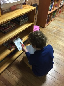 tncs-student-reads-from-school-library