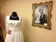 The dress on display next to the bride and groom