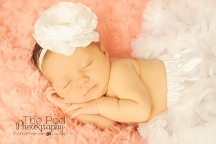 peach and white newborn baby
