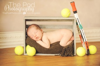 newborn-baby-tennis-themed-balls-sleeping-photography
