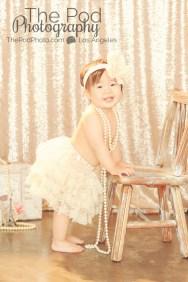 Best-Styling-One-Year-Old-Cake-Smash-Girl-Studio-Session-Lace-Tutu-Pearls-Pod-Glow-Paris-Set-Sparkle-Sequins-Girly-Santa-Monica-Baby-Photographer