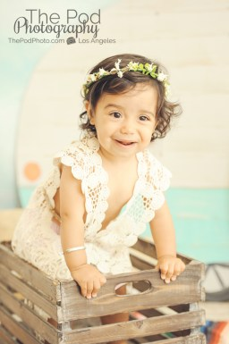 One-Year-Old-Baby-Girl-Portriats-Bohemian-Flower-Headband-Crochet-Dress-Baby-In-Bucket-Venice-Beach-Photographer