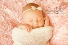 smiling-newborn-baby-girl-pink-bow-on-head-unique-photography-west-los-angeles