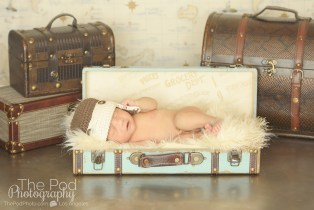 infant-in-blue-suitcase-wearing-an-aviator-hat