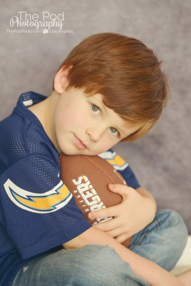 cute-boy-holding-a-football-photographed-at-a-professional-photography-studio-in-los-angeles