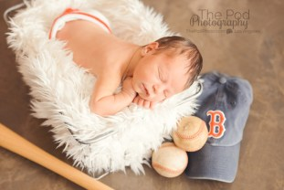 baseball-baby-asleep-in-basket