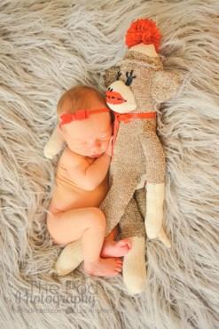 baby-hugging-sock-monkey