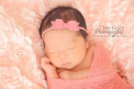 swaddled-newborn-baby-pink