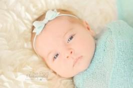 awake-infant-with-blue-eyes