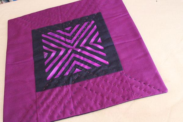 finished big stitch foil pillow