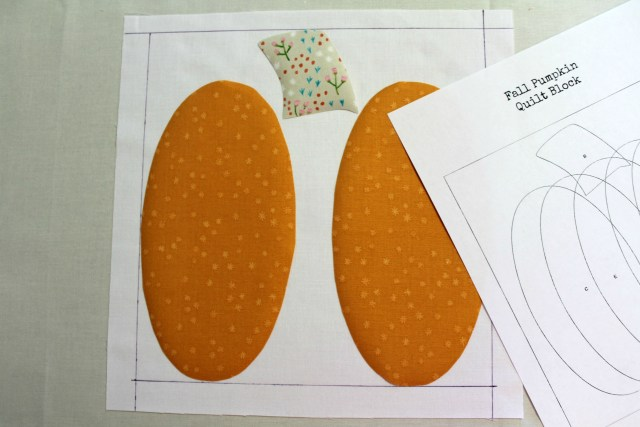 placing first pumpkin pieces for quilt block