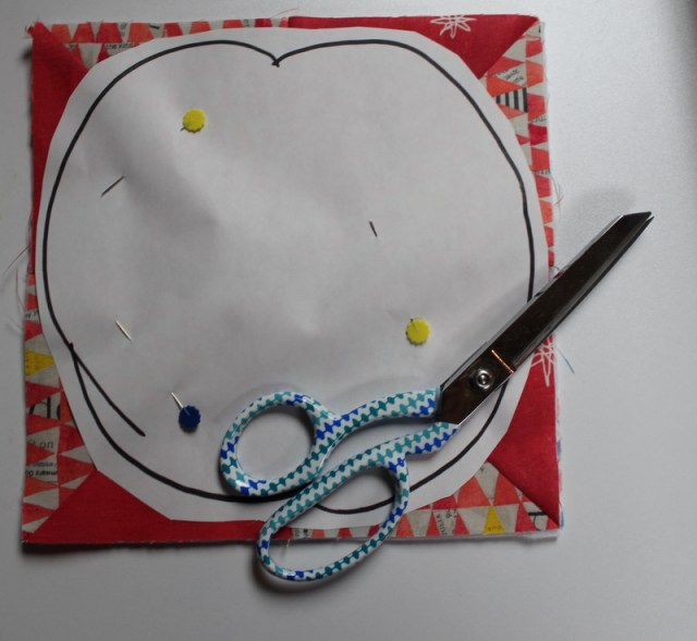 pin template onto quilt sandwhich