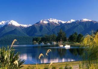 Te Anau is beautiful on a sunny clear day, and marvelously moody and evocative on a cloudy misty day too