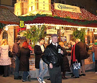 One of the Christmas markets, blazing with light in the evening.