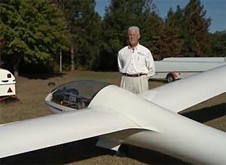 Glider pilot Robin Fleming and his glider.
